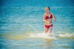 青少年的女孩比基尼泳装 库存图片