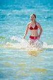 青少年的女孩比基尼泳装 库存照片