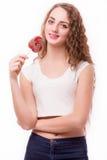 青少年的女孩用糖果在手上 库存照片