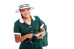 青少年的女小学生片剂 库存图片