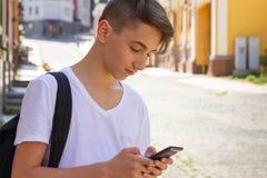 青少年的男孩外部画象  免版税图库摄影