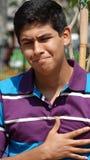 青少年的男孩胸口痛或悲伤 图库摄影