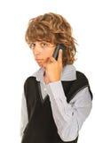 青少年的男孩谈话由电话 免版税库存图片