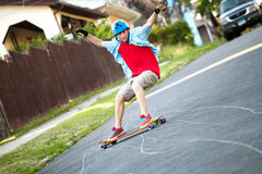 青少年的Longboarder 免版税图库摄影