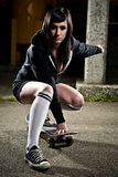 青少年美丽的女孩的溜冰者 图库摄影