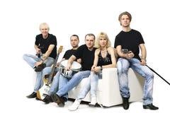 青年与仪器的音乐小组 笤帚查出的白色 免版税库存照片