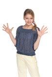 青春期前的女孩做手势 图库摄影