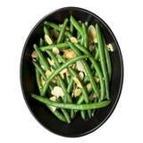 青豆用在黑碗的敬酒的杏仁 免版税库存照片
