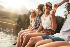 青年人坐一只跳船在一个晴天 图库摄影
