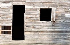 老19世纪美国移居者家简单的门和窗口  免版税库存照片