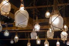 非常异常的灯由玻璃瓶制成 库存照片