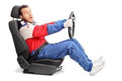 非常快速地驾驶年轻汽车的竟赛者 免版税库存图片
