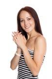非常有迷人的微笑的美丽的少妇 免版税库存照片