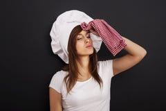 非常疲乏的女性厨师 免版税库存图片
