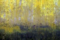 非常老退色的黄色墙壁纹理 库存照片