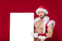 非常肌肉被镀青铜的英俊的性感的圣诞老人 图库摄影