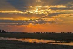 非洲徒步旅行队日落 库存图片