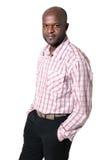 非洲生意人愉快的查出的纵向微笑 免版税图库摄影