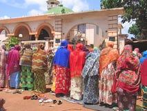 非洲祈祷的妇女 免版税库存照片