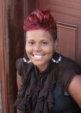 非洲裔美国人的头发的红色妇女 库存照片