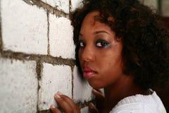 非洲裔美国人的女孩她的倾斜 库存图片