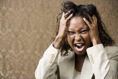 非洲裔美国人的恼怒的俏丽的妇女 免版税库存图片