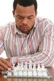 非洲裔美国人的棋男性使用 免版税库存图片