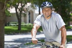 非洲裔美国人的自行车人骑马 图库摄影