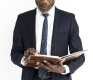 非裔举行书 免版税库存照片