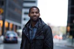 年轻非裔美国人的专家画象在城市 免版税图库摄影