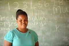 非洲儿童的学校教师 库存照片
