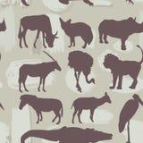 非洲动物无缝的样式 剪影 向量 免版税图库摄影
