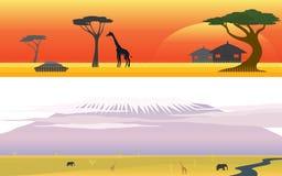 非洲大草原徒步旅行队和巨大山风景 免版税库存照片