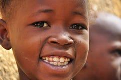 非洲女孩一点纵向微笑 库存图片