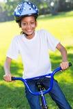 非洲女孩自行车 库存图片