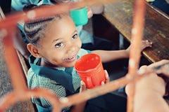 非洲女小学生 免版税库存照片