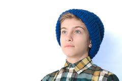 非离子活性剂男孩的画象帽子的 库存照片