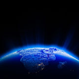 非洲市光在晚上 库存图片