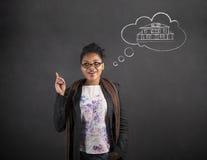 非洲黑板背景的妇女好想法梦之家 库存照片