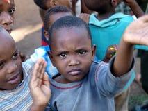 非洲男孩孤立行 库存图片