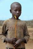 非洲男孩的画象有灼烧的蜡烛的在手上 库存图片