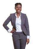 从非洲的愉快的女实业家 免版税库存图片
