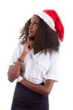 非洲裔美国人的帽子圣诞老人佩带的&# 免版税库存图片