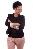 非洲裔美国人的胳膊被折叠的微笑的&# 免版税库存图片
