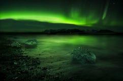 水面上极光的北极星 图库摄影
