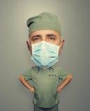 面具的外科医生在灰色 免版税库存图片