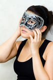 面具的隐姓埋名的妇女 图库摄影