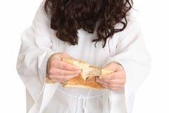 面包中断了产生耶稣逾越节感谢 库存照片