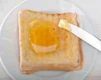 面包和蜂蜜 免版税库存照片