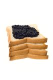面包和黑色鱼子酱 免版税库存照片